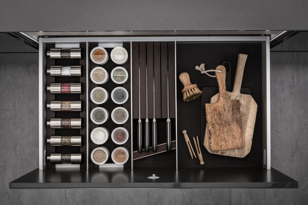 SieMatic - dark smoked cheshunt lining and moveable aluminium panels spice mills and knife holder